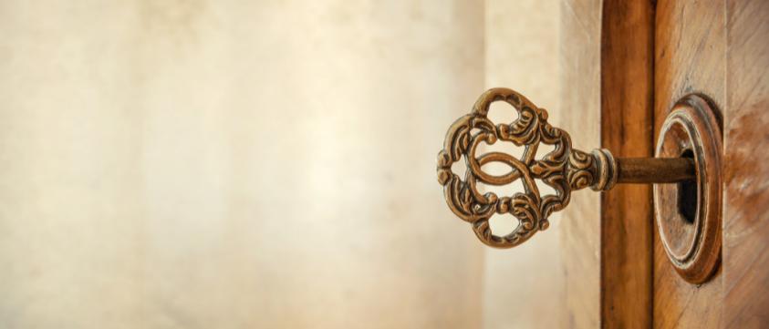 Key unlocking door symbolising unlocking our potential